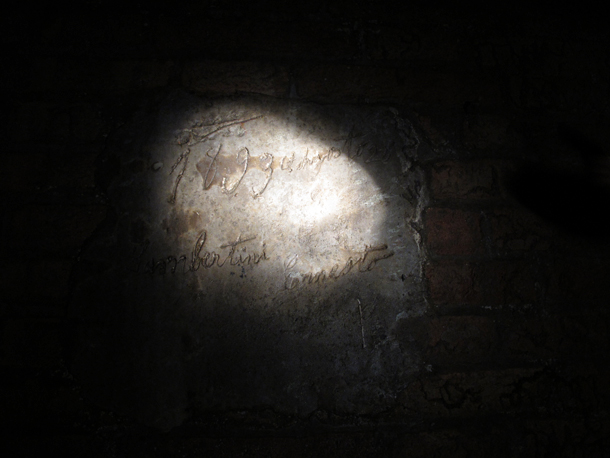 1893 carpenter's signature. Underground tour of Bologna with Massimo Brunelli. Photo © Matilde Soligno